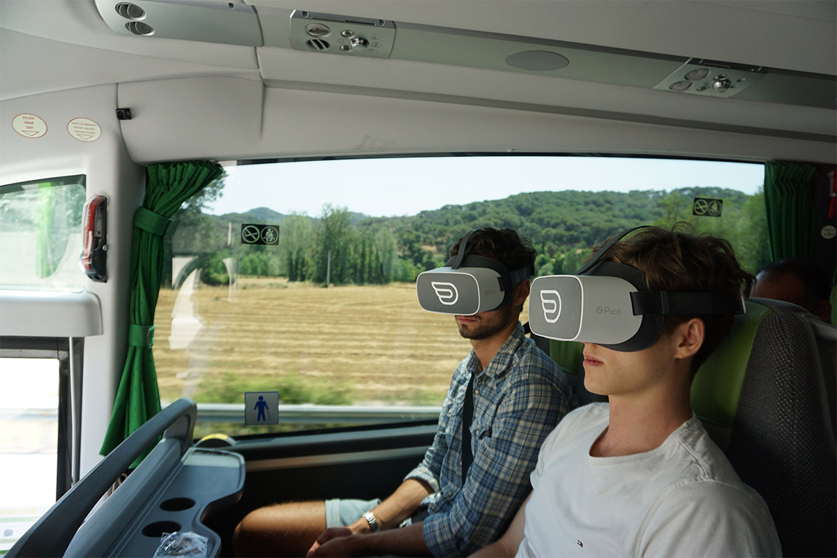 Two mens with Pico headsets having inflight vr experience on flixbus