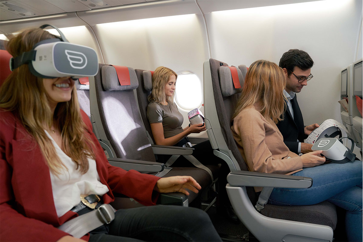 Group of people having a inflight VR experience inside of a Iberia cabin airplane
