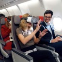 Women having a inflight vr experience inside a iberia's cabin airplane